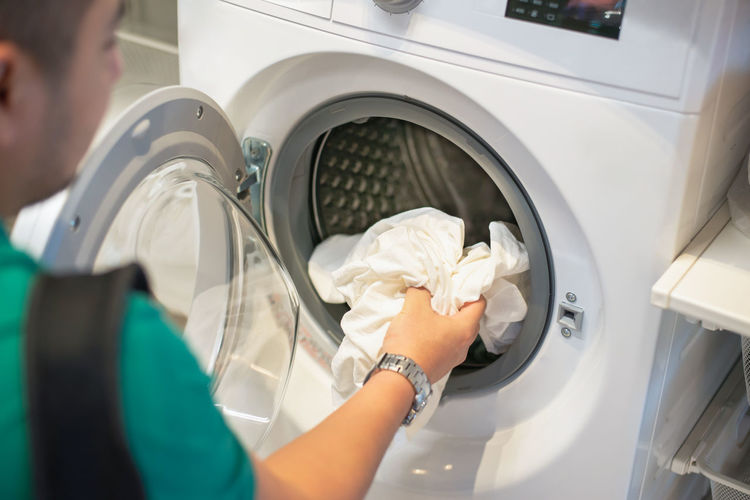 Machinery Washing Machine Indoors  Headshot Adult One Person Real People Household Equipment Cleaning Laundry Holding Washing Men Occupation Working Hygiene Portrait Lifestyles Women Housework Laundromat Care