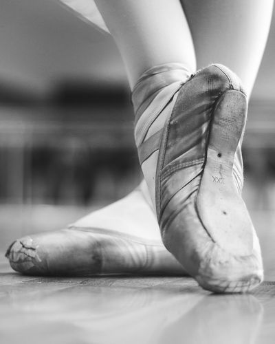 Ballet Pointe Shoes Pointe Shoes Ballet Ballet Dancer Ballet Shoes Close-up Day Focus On Foreground Human Body Part Human Foot Human Hand Human Leg Indoors  Lifestyles Low Section Men One Person People Real People Resting