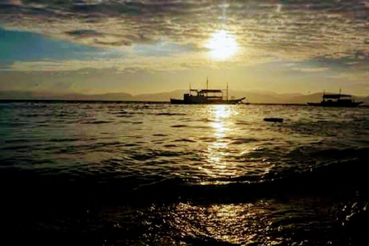 Sea Reflection Cloud - Sky Water Nautical Vessel Sunset Transportation Outdoors Nature No People Tranquility Sky Oil Industry Horizon Over Water Scenics Offshore Platform Low Tide Beauty In Nature Tall Ship Day Albay,Philippines Travel Destinations Vacations Dramatic Sky