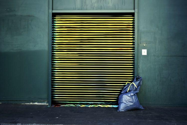 Yellow closed door of shutter