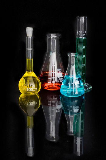 Test tubes and beakers with colorful liquids in laboratory
