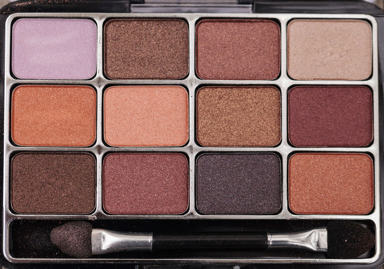 Close-Up Of Make-Up Brush With Palette