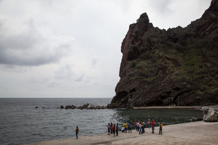 Ulleungdo is the most mysterious island. It is located at East Sea of South Korea. I have been there for 13 days for photo travel. Beach Beauty In Nature Cliff Horizon Over Water Island Large Group Of People Leisure Activity Lifestyles Men Nature Person Rock - Object Scenics Sea Seaside Sky Tonggumi Tourism Tourist Tranquil Scene Tranquility Travel Ulleungdo Vacations Water