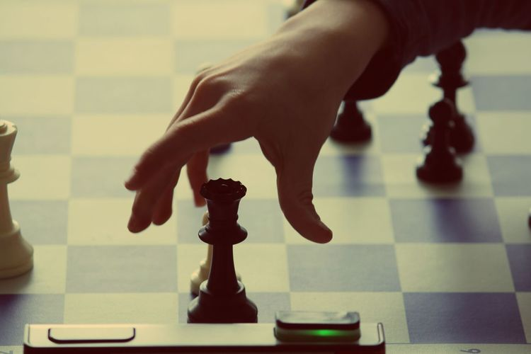 Cropped Image Of Person Playing Chess