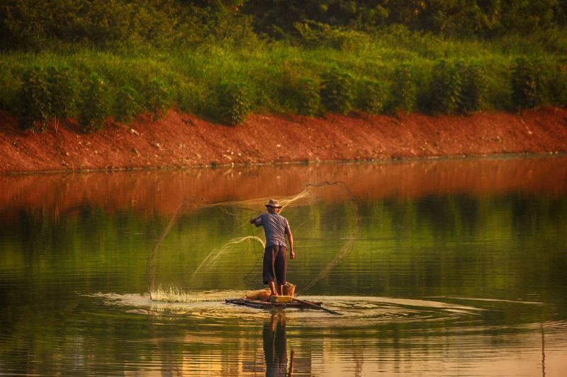 Man working in lake