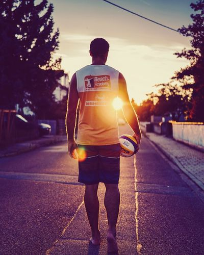 Rear View Road Full Length Sunset Outdoors Men One Person Tree Real People Sport Standing Sky Sportsman Adult Adults Only People Sony A6000 SonyAlpha6000 Volleyball Photooftheday Picoftheday Photography