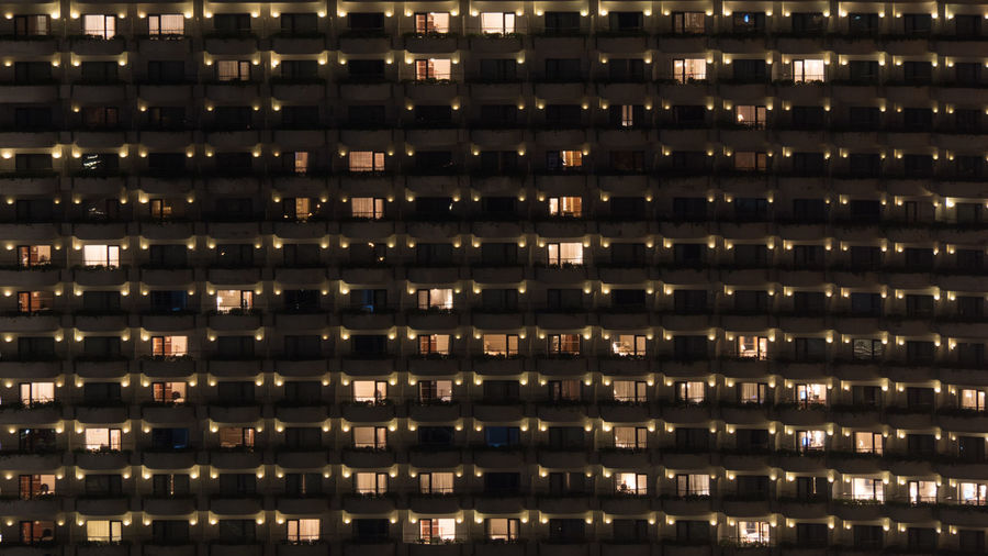 Facade of highrise apartment block with balconies. Electric lights in some windows. Housing in Bangkok, Thailand Apartament Architecture ASIA Bangkok Block Building City Dwelling Electricity  Façade Highrise Horizontal House Illuminated Metropolis Multistorey Night Outdoors Residential  Window
