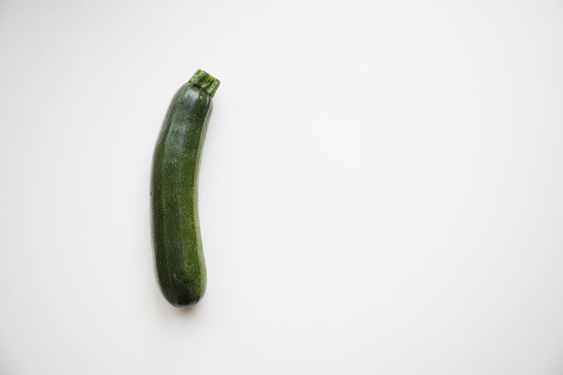 Close-up of green pepper against white background
