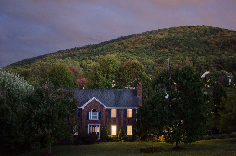 House on mountain against sky