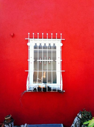 White window in red wall Red Studio Shot House Red Background No People Close-up White On Red Red Wall White Window In Red Wall Red And White Contrasting Colors Contrast