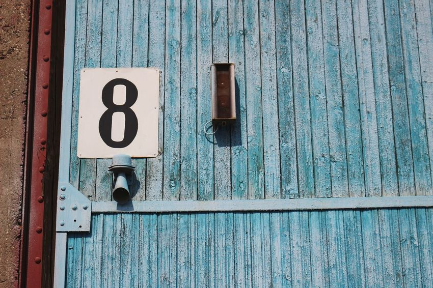 Speeker Sign Letter Number 8 Wall - Building Feature Wall Wall Painting Painted Wall Painted Paint Blue Paint Rusted Metal  Rusted Rust Detail Exterior Exterior View Exterior Building Colorful Blue Communication Rusty Door Wood - Material Metal Number Close-up Architecture Building Exterior