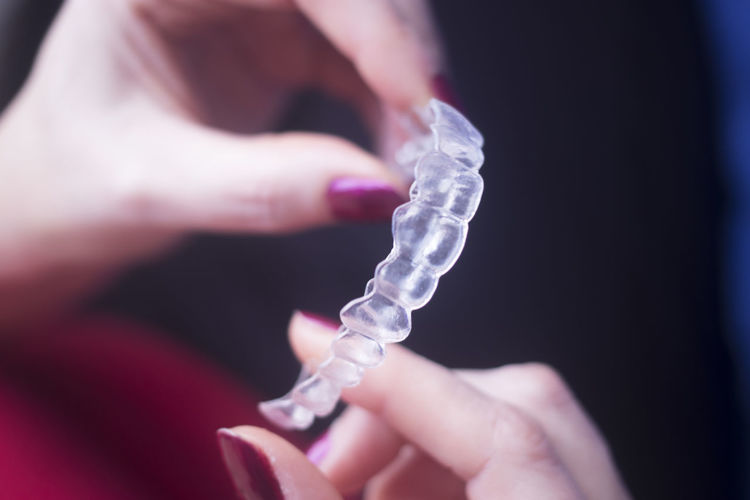 Close-up of hand holding mouthguard