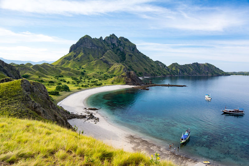 Aerial View of the Padar Island Bay, Where We Come Island Komodo National Park, Indonesia Field Green Color INDONESIA Mountain View Top Tourist Trekking Walking Around Boat Hiker Hikers Island Mountain Nature Outdoors Padar Padar Island Pulau Route Tranquility Traveler Water
