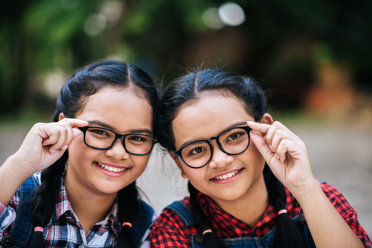 Cheerful Emotion Eyeglasses  Focus On Foreground Front View Glasses Happiness Headshot Leisure Activity Lifestyles Looking At Camera Outdoors People Portrait Positive Emotion Real People Smiling Teenager Togetherness Women Young Adult Young Women