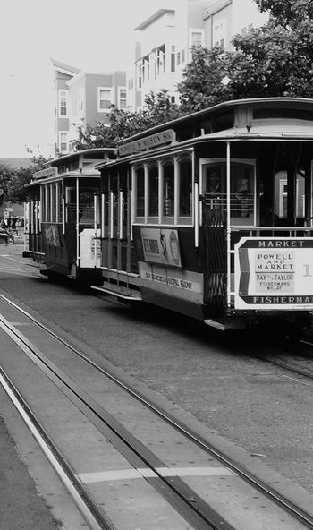 San Francisco City Streets  are bustling as the Trolley goes through the intersection near Fisherman's Wharf Hanging Out Relaxing Taking Photos Travel Photography Road Trip Best Of EyeEm Eye4photography  Original Photography Mobile Photography Monochrome Blackandwhite Photography Urban Lifestyle Urbanphotography California Dreaming Taking Photos Choatephotos Choatgrapy No People Streetphotography Breathing Space Investing In Quality Of Life Breathing Space Investing In Quality Of Life