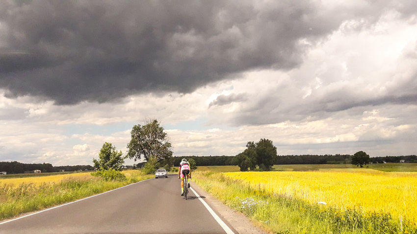 Bicycle Road Cycling Cloud - Sky One Man Only Adults Only One Person Racing Bicycle Outdoors Headwear Only Men People The Way Forward Full Length Sky And City Poland Is Beautiful Day EeyemBestEdits Poland 💗 Travelling Atmospheric Perspective Week Of Poland Beauty In Nature Road Landscape