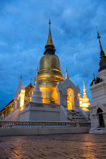 Golden stupa of Suan Dok temple at dawn! Architectural Feature Architecture Chiang Mai Cloud - Sky Cloudy Dawn Exterior Golden Golden Pagoda Golden Stupa Illuminated Monastery No People Outdoors Sky Sunset Temple Thailand Tourism Travel Destinations Wat Suan Dok