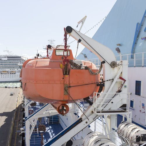 Lifeboat on cruise ship at pier