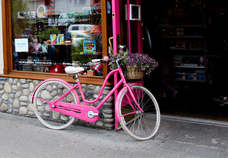 Bicycle parked on street in store
