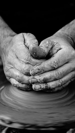 Cropped Hands Of Potter Making Craft Product