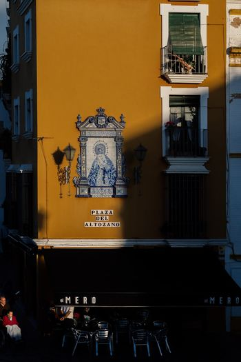 Red Maria Trynidada Street Scene Street Photography Sevilla Andalucía Andalucía Leicacamera Sevilla Red Architecture Built Structure Building Exterior Window No People Text Communication Wall - Building Feature Building City Illuminated Outdoors Art And Craft Yellow Table Day Residential District The Street Photographer - 2018 EyeEm Awards