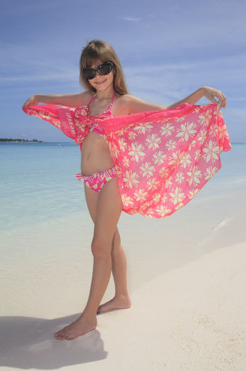 Sunny day at the seaside Beach Beauty Casual Clothing Day Full Length Leisure Activity Lifestyles M Nature Outdoors Person Pink Color Posing Red Sand Sandy Shore Summer Sunlight Sunny Tranquility Vacations Water Young Adult Young Women