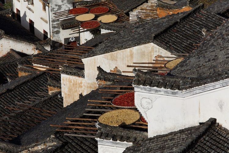 High angle view of food drying on rooftops