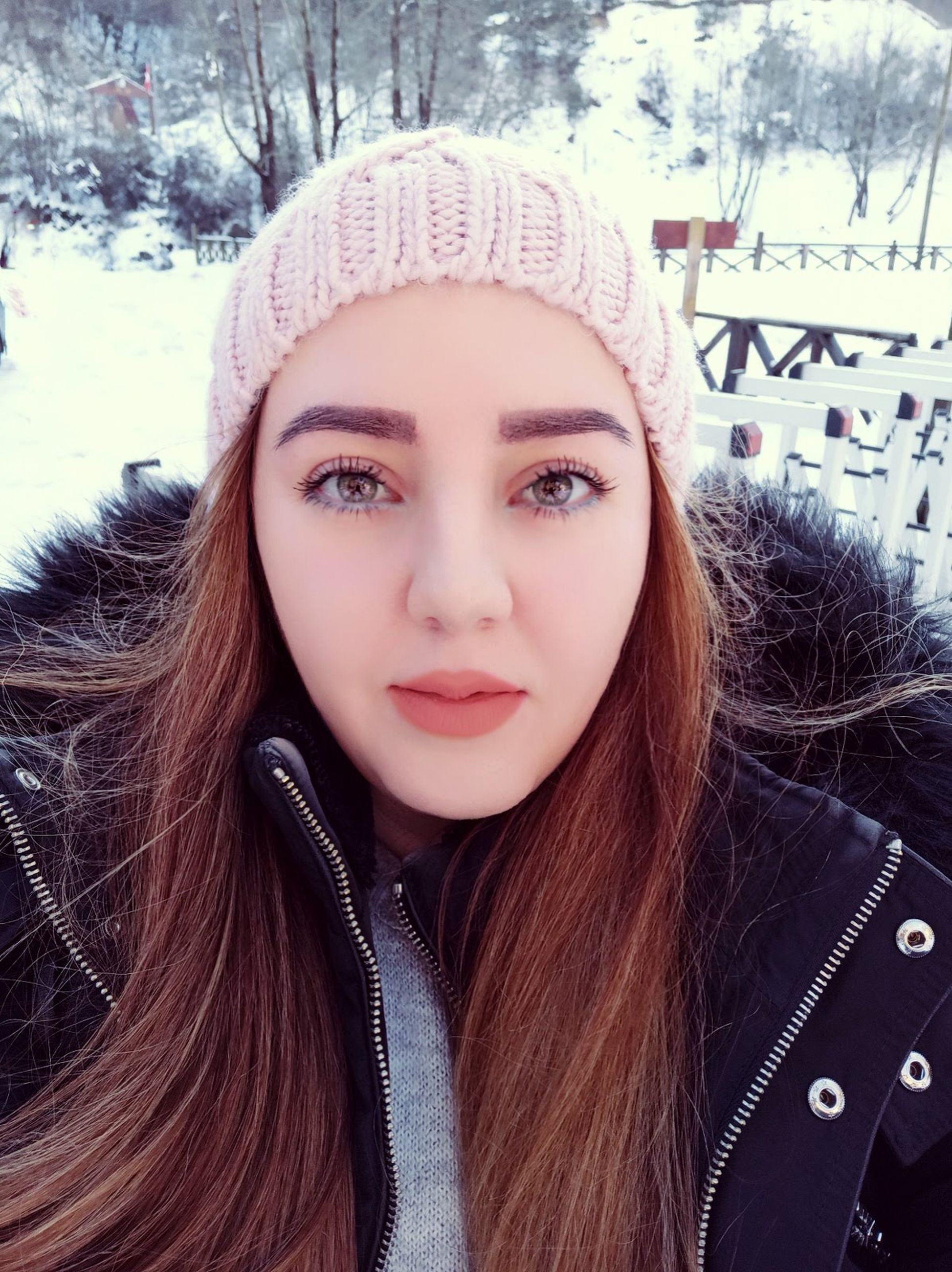 winter, portrait, one person, cold temperature, snow, warm clothing, clothing, front view, young adult, looking at camera, women, headshot, long hair, human hair, hairstyle, adult, hat, leisure activity, fashion, lifestyles, human face, knit hat, person, cap, day, brown hair, nature, knit cap, human head, close-up, beanie, outdoors, child, photo shoot, jacket, teenager, winter coat, fur, tree, human eye, coat, skin