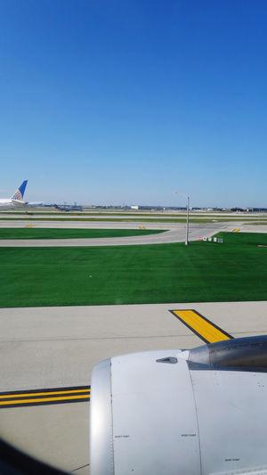 Airplane on runway against clear sky