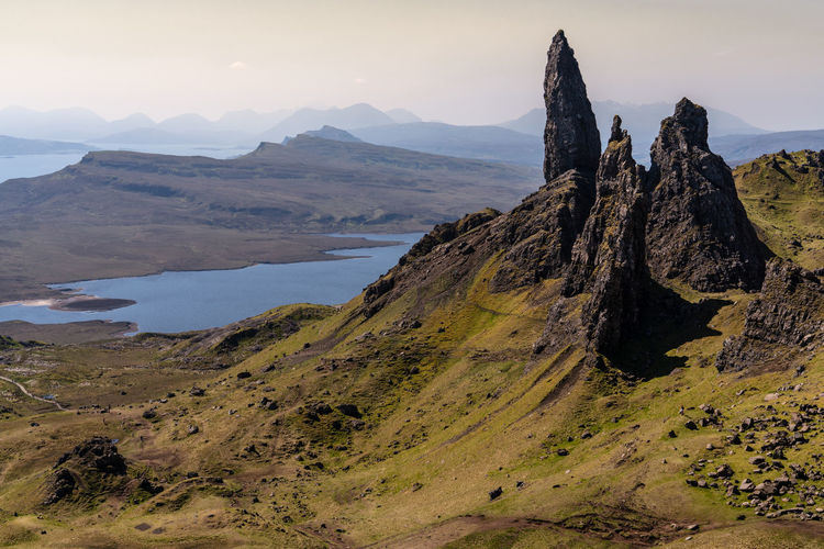 Beauty In Nature Day Environment Formation Geology Idyllic Isle Of Skye Lake Land Landscape Man Of Storr Mountain Mountain Peak Mountain Range Nature No People Non-urban Scene Peak Remote Rock Rock - Object Scenics - Nature Sky Solid Tranquil Scene Tranquility The Great Outdoors - 2018 EyeEm Awards The Traveler - 2018 EyeEm Awards