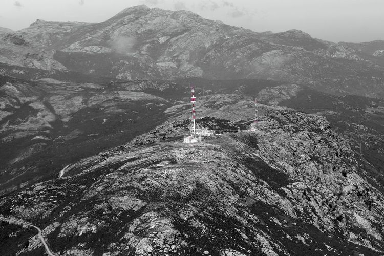 High angle view of communications tower on mountain