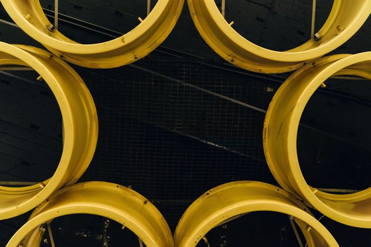 Yellow Metal Structure Hanging On Ceiling At Subway Station