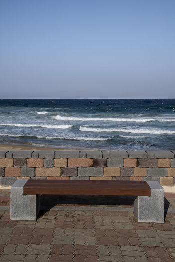 winter Hwajinpo Beach in Goseong, Gangwondo, South Korea Hwajinpo Beach Sea Water Horizon Horizon Over Water Land Beach Sky Nature Clear Sky Wave Beauty In Nature Outdoors Scenics - Nature No People Day Tranquility Seat Tranquil Scene Motion Horizon Over Sea