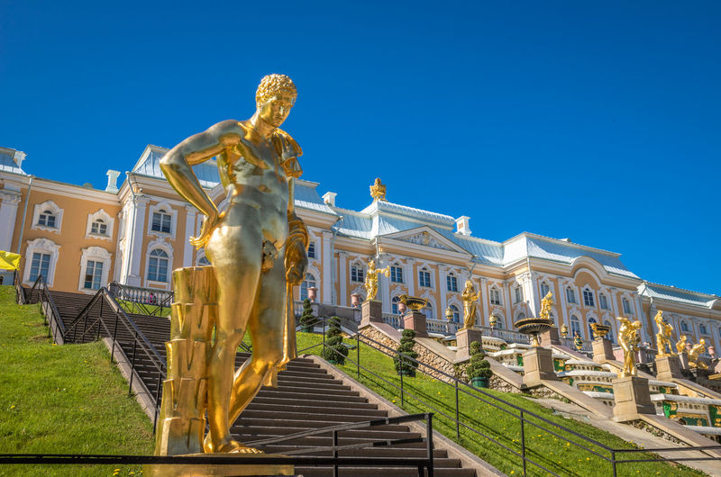 Statue of historic building against blue sky