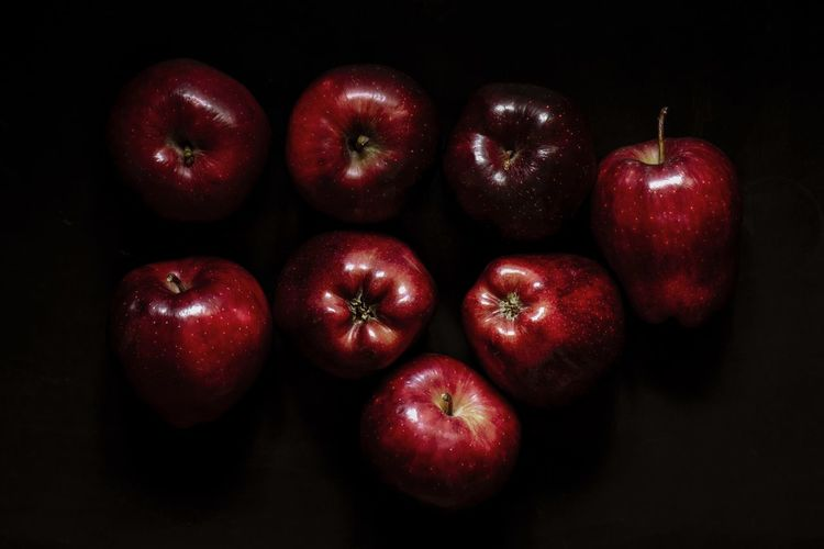 Fresh red apple on a black Dark Healthy Eating Food And Drink Food Freshness Red Wellbeing Fruit Still Life Group Of Objects Apple - Fruit Close-up Studio Shot Apple Black Background Side By Side Indoors