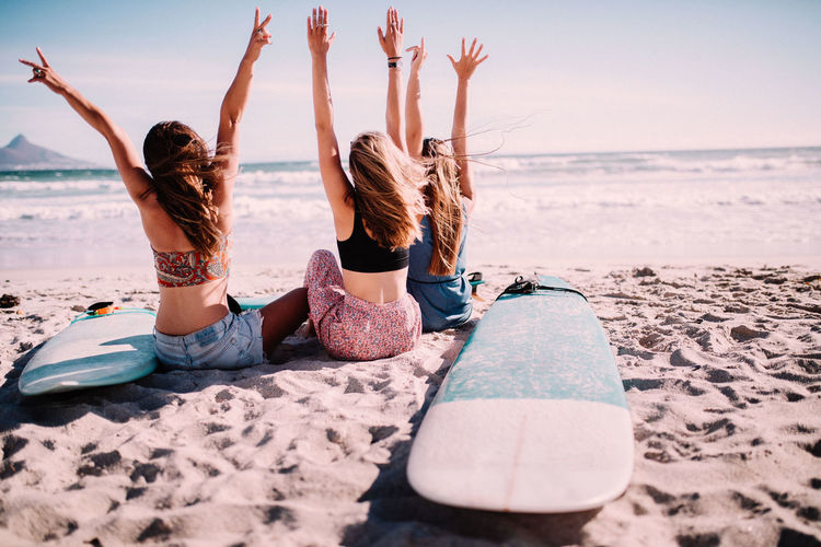 Beach Sea Water Sand Togetherness Trip Holiday Leisure Activity Vacations Enjoyment Nature Friendship Human Arm Arms Raised Emotion Fun Relaxation Positive Emotion Outdoors Vacations Happy People