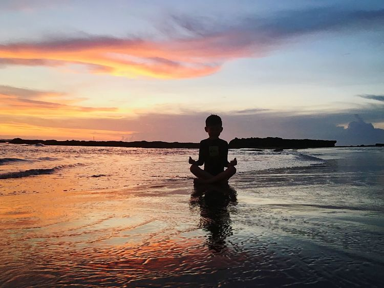 And he feels this power of Lord Megapixel Ocean View Evening Sky Everything In Its Place Bali Canggu Beachphotography Beach Kids Yoga Meditation Yogakids Nature Sunset