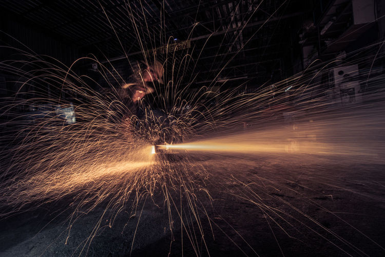 Blurred Motion Burning Fire Geometric Shape Glowing Heat - Temperature Illuminated Industry Light Trail Long Exposure Men Metal Industry Motion Nature Night One Person Real People Skill  Sparkler Sparks Speed Wire Wool EyeEmNewHere