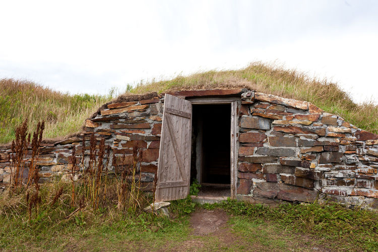 Open door historic vintage root cellar dug underground near Elliston, Newfoundland, NL, Canada Historic Vintage Old Earth Root Cellar Dugout Elliston Newfoundland NL Canada Underground Door Cold Storage Traditional Building Exterior Exterior Building Architecture Built Structure Grass Nature No People Outdoors Building Exterior Rural Scene Entrance Wood History Stone Wall The Architect - 2019 EyeEm Awards
