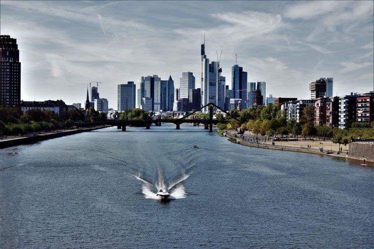 View of city with buildings in background  photographyfrankfurt