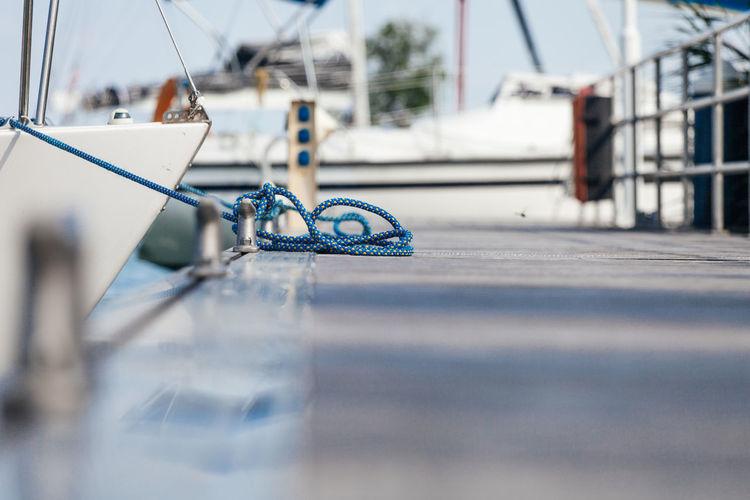 Close-up of boat moored at harbor