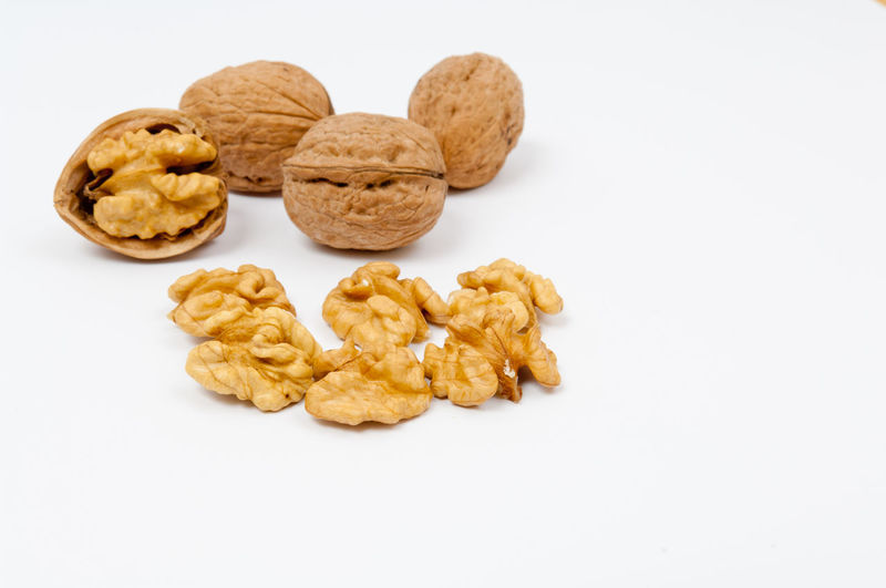 Whole walnuts and walnut kernels on white background Brown Food Food And Drink Healthy Eating Isolated Kernel No People Raw Shell Shelled Walnut Walnuts White Background Yellow