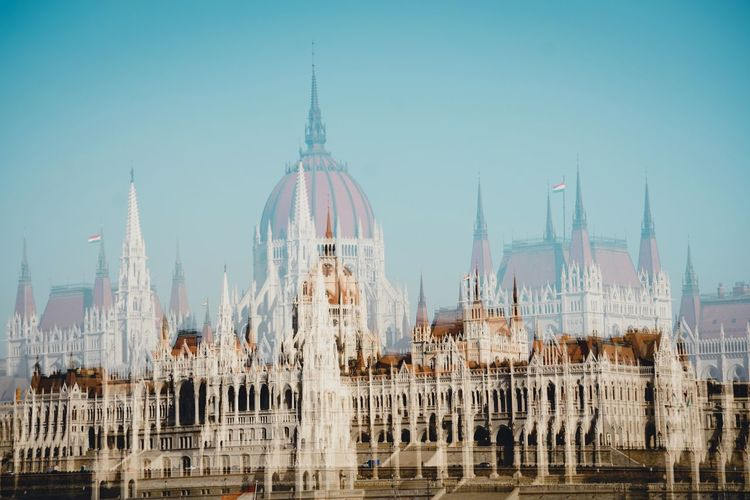 Double exposure of hungarian parliament building and church