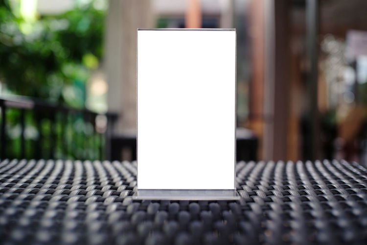 Advertisement Blank Close-up Communication Copy Space Day Empty Focus On Foreground Geometric Shape No People Outdoors Paper Pattern Seat Selective Focus Still Life Table Technology White Color