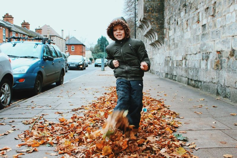 Autumn joyful Leaves Autumn Childhood Child One Person Full Length Standing Boys Offspring Casual Clothing Mode Of Transportation Front View Car Motor Vehicle Portrait City Transportation Warm Clothing Outdoors Domestic Mammal