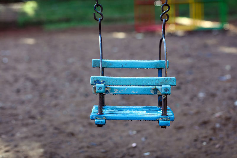 Empty Baby Swing Hanging At Playground