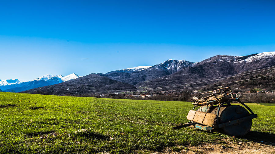 Mountain Irrigation Equipment Clear Sky Agriculture Rural Scene Tree Field Sky Mountain Range Landscape Agricultural Field Cultivated Land Farmland Farm