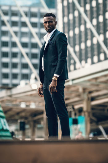Portrait of success and confident african businessman outdoor posing outdoor in modern city.