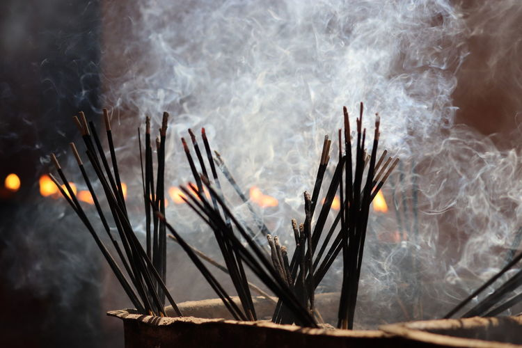 Close-up of smoke emitting from incense sticks
