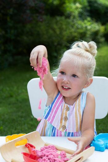 Portrait of cute girl holding ice cream